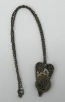 Mixed metal steampunk heart pendant.( clock detail)
