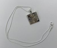 Mother of pearl shell square pendant.
