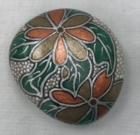 Hand painted copper and bronze flower design message stone with display stand