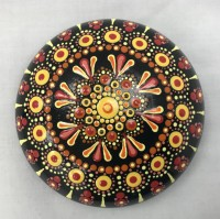 Art stone, yellow and red, hand painted mandala design with display stand.