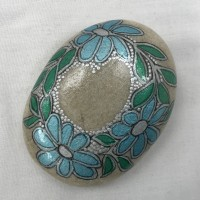 Hand painted flower design message stone with display stand.