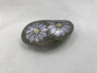 Hand painted flower and leaf design message stone with display stand.