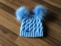 Blue hat with blue pompoms
