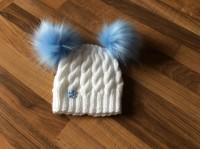 White hat, blue pompoms